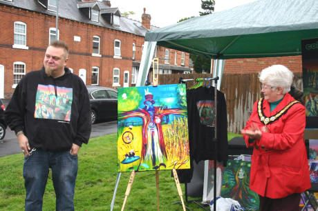 Steve Pound and Mayor Pat Witherspoon with the new painting. (s)  HEADLESS Cross Green was the location for the grand unveiling of a painting inspired by the site.  Mayor Pat Witherspoon (right) uncovered the artwork by Steve Pound (left) during Apple Day at the community orchard.  Steve was inspired to paint Headless Cross Scarecrow, using oils on canvas, by the scarecrows displayed in the area at the May Fayre earlier this year.  Read more: Headless Cross painting revealed   Redditch…