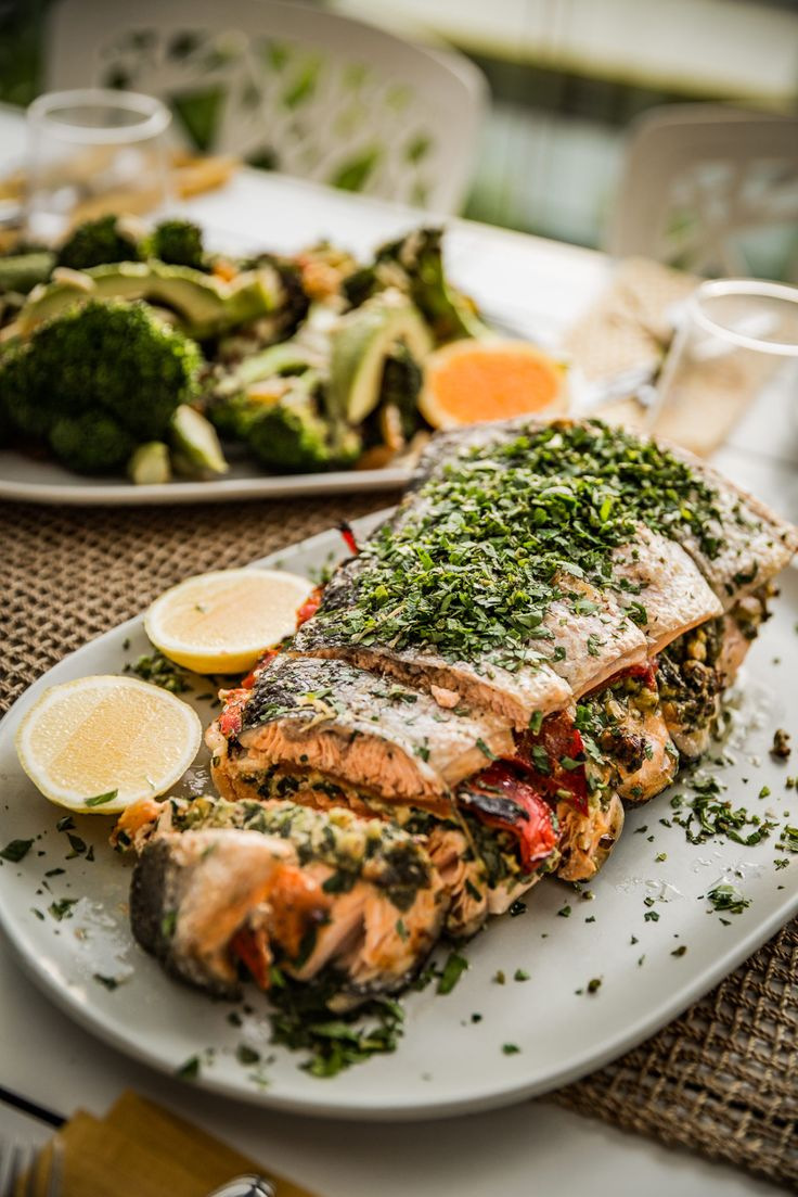 Bondi Harvest Pesto baked Salmon !  Our finale episode and recipe for the first season of Bondi Harvest Summer Cooking calls for a party and a feast to go along with it.  There is no feast more impressive or fit for a party of this calibre than my Baked Pistachio Pesto and Roasted Capsicum stuffed King Salmon. The recipe sounds intimidating but trust us, this is incredibly simple to make. Serve your salmon with my grilled broccoli, picked avocado salad