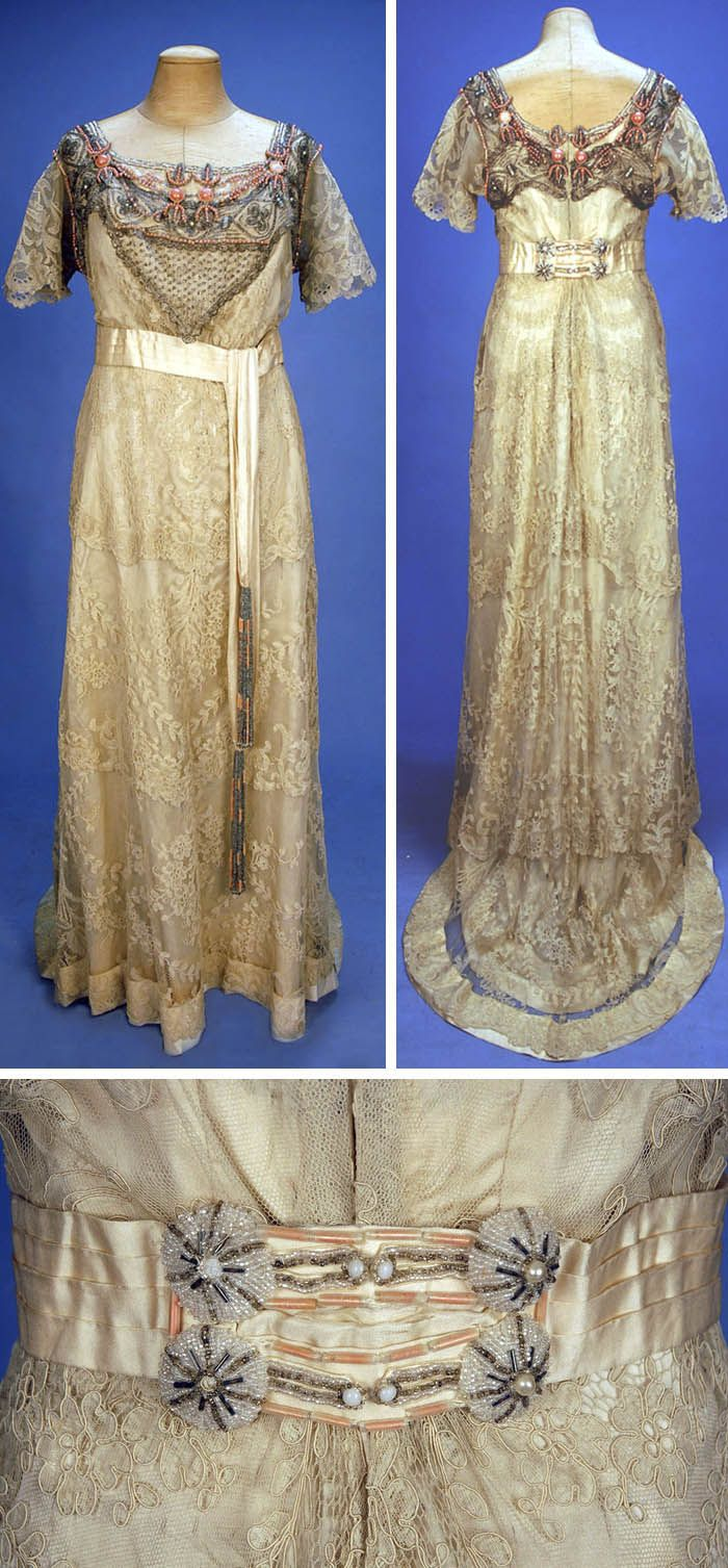 Beaded and trained lace gown, ca. 1915. Cream floral lace on net with short sleeves. Crystal and salmon pink beaded bodice overlay, cream silk sash with long beaded tassels and beaded back detail. Back closure, three-layer skirt, lined in cream silk. Whitaker Auctions