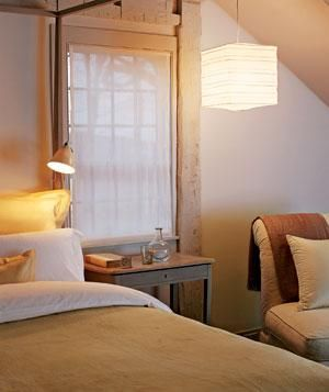 Soft lighting overhead and a clip-on task lamp add to the sense of warm comfort.