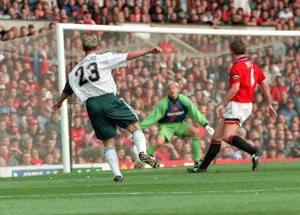 Robbie Fowler scores at Old Trafford in 1995