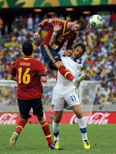Italy 0 Spain 0 (6-7 pens) in 2013 in Fortaleza. Sergio Ramos gets above Alberto Gilardino for the header in the Confederations Cup Semi Final.