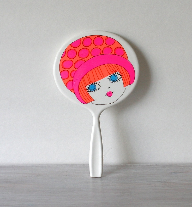 Circa 1960s Mod Hand Mirror Pink Orange. $12.00, via Etsy.