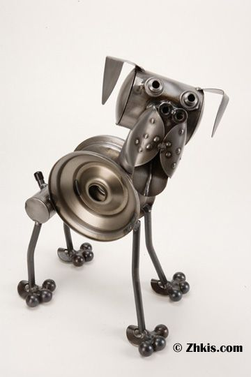 Rottweiler dog sculpture made of metal and uniquely different. This piece has a whimsical and fun look to it. Handcrafted here in the US.