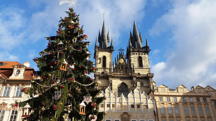 Christmas on the Prague Old Town Square with Tree and in the background, the Church of Our Lady Before Tyn.