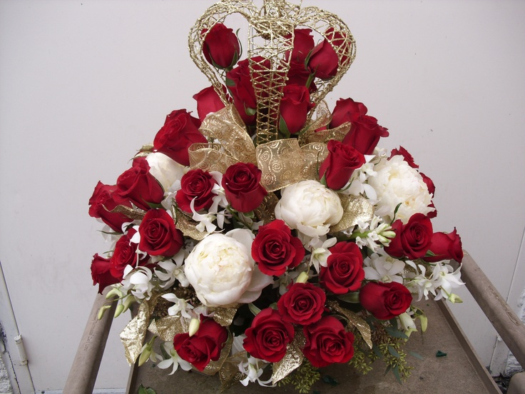 White and red flowers with crown centerpiece arrangement