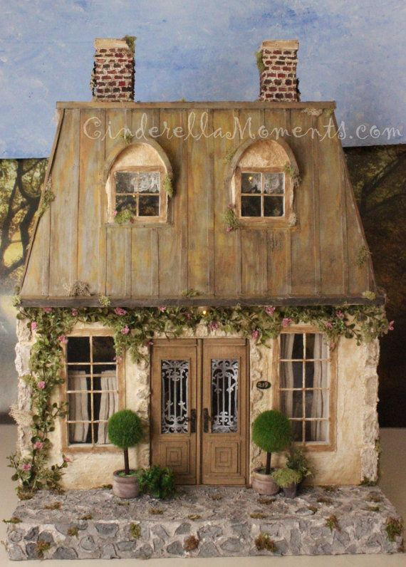 La Maison de Campagne is a 1/12 (1 inch) scale custom french style dollhouse with a mansard roof. This dollhouse has battery operated
