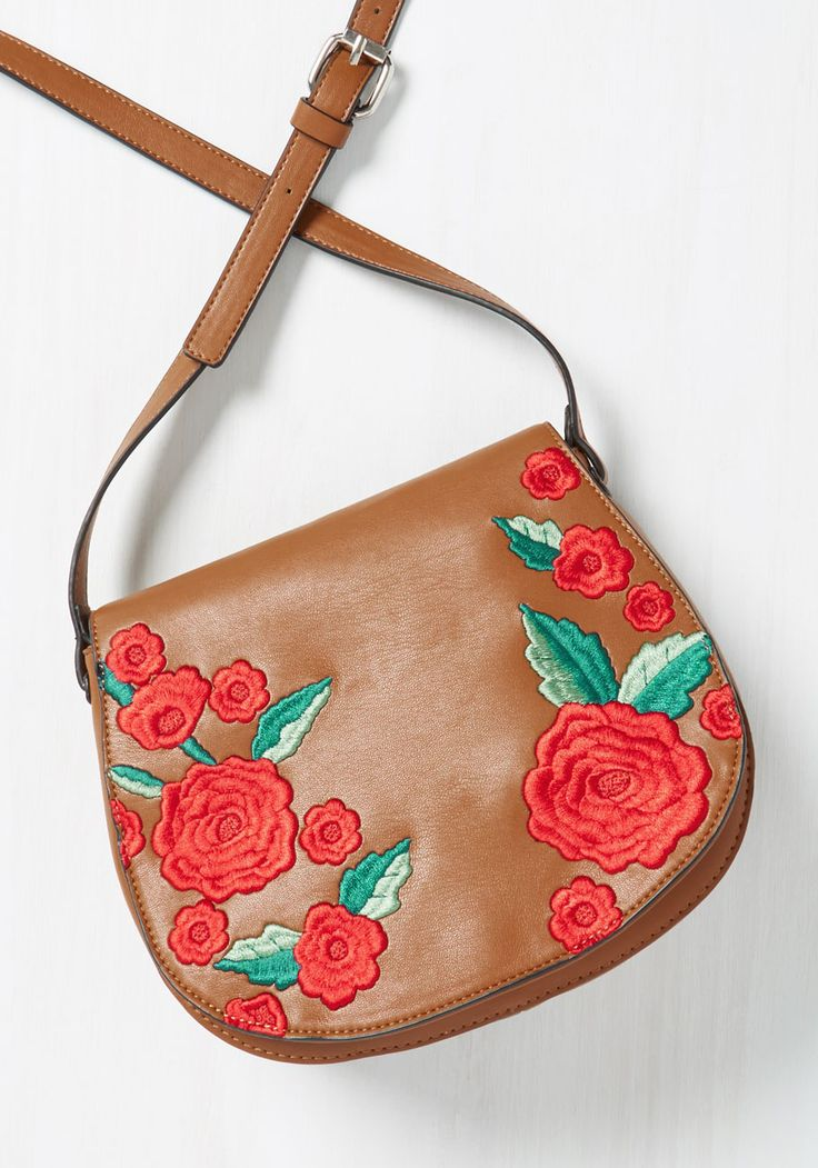 I've Austin Wondered Bag. Youve pondered what it might be like to meander down Sixth Street with this brown saddle bag over your shoulder, and now youre about to find out! #red #modcloth