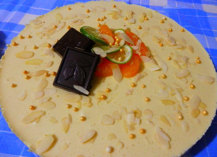 tortulet cu mandarine ci ciocolata alba..un deliciu :D  http://sweetsbynicole.org/?s=tortulet+cu+mandarine+si+ciocolata+alba&submit=Search