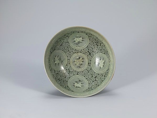 Bowl decorated with peonies, Korea, Goryeo dynasty (918–1392), 13th century. Stoneware with inlaid and reverse-inlaid design under celadon glaze. H. 2 5/8 in. (6.7 cm), L.2016.43.7a, b. Photograph courtesy the National Museum of Korea