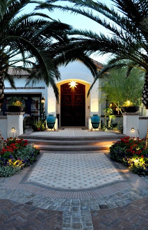 Beautiful outdoor AZ space.  Love the mix of pavers, aqua urns, and desert landscaping! Great lighting.