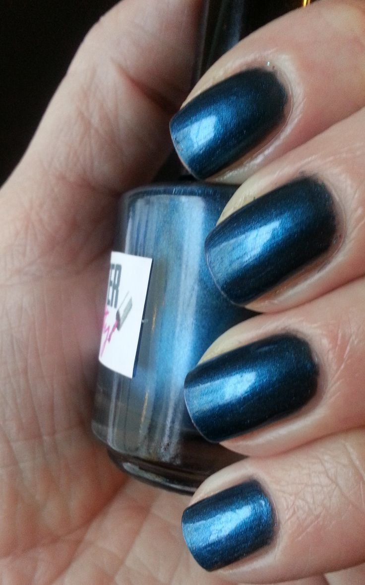 A demanding deep blue pigment polish with black undertones. Reminiscent of the iridescent blues of a raven's wings; it looks more black at some angles, and more blue at others, with a pop of blue-green showing up in some lighting.
