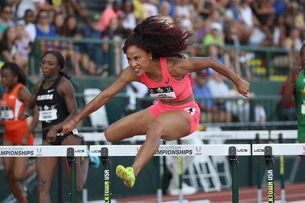 News Photo : Queen Harrison competes in the Womens 100 Meter...