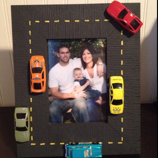 For my sons car room! Painted frame gray and used a yellow paint maker for stripes. Hot glued a few matchbox cars and it's done! Could use the Disney Cars too!