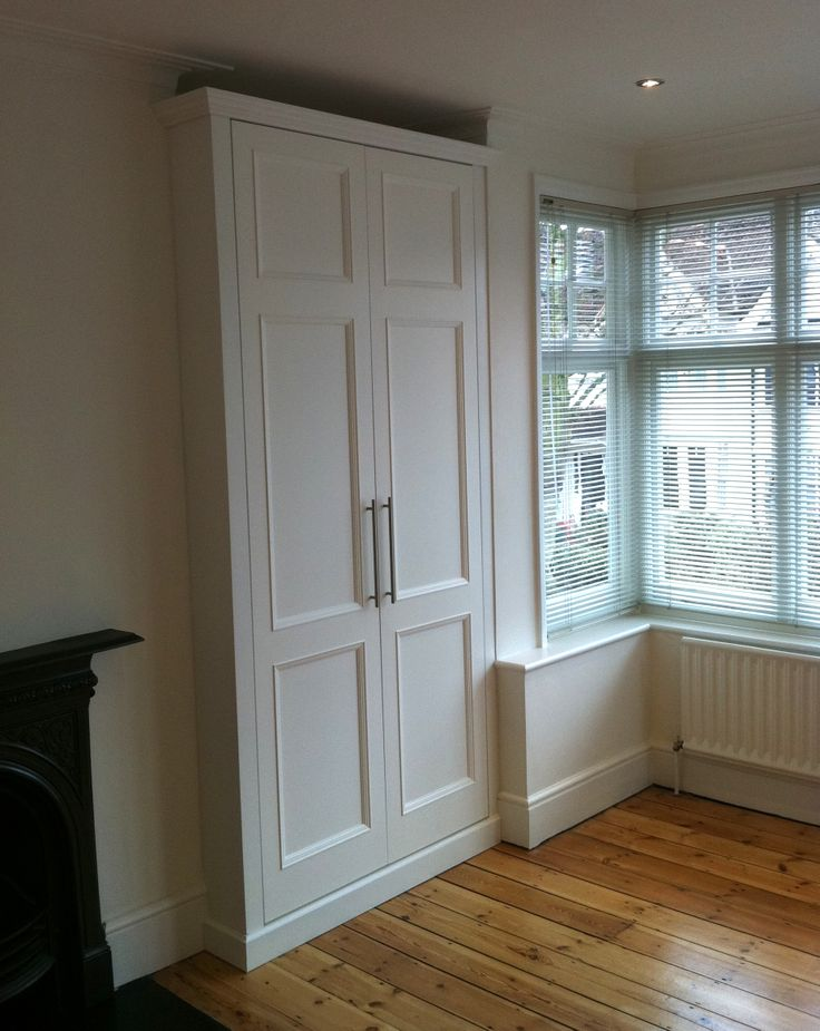 Traditional style made to measure fitted wardrobe with traditional paneled doors. Hand made in London. #BespokeFurniture www.timamery.com