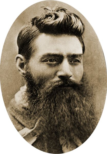 """Edward """"Ned"""" Kelly (June 1854 or 1855 – 11 November 1880) was an Irish Australian bushranger. He is considered by some to be merely a cold-blooded killer, while others consider him to be a folk hero and symbol of Irish Australian resistance against the Anglo-Australian ruling class. Photo 1880 (Wikipedia)"""