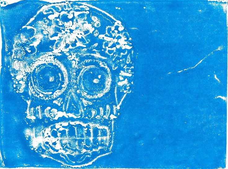 A4 illustration of a Mexican skull using subtractive monoprinting method. A layer of blue caligo ink was applied to a small sheet of lino. After this a sheet of paper was placed on the ink and the skull image was hand-drawn onto the paper using a chinagraph pencil (this leaves a unique stencil on the lino/ plexiglass/ glass with which to print with) and printed using a roller (to ensure an even amount of pressure). #monoprint #illustration #skull