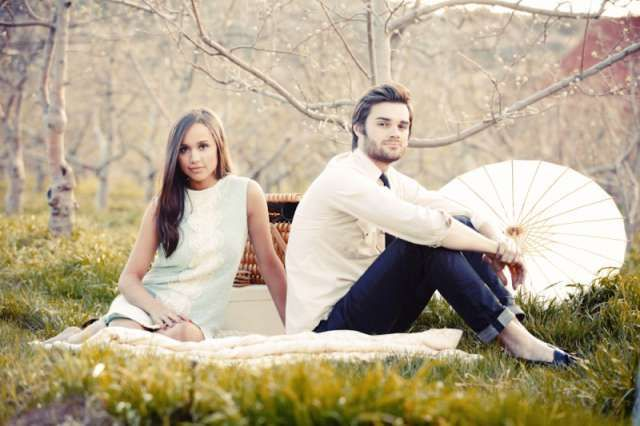 50-engaged-couple-picnic-blanket-parasol-umbrella-vintage-feel