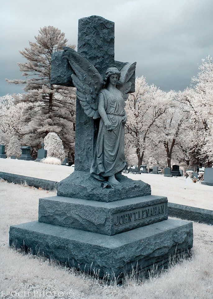 Infrared Angel 2 by photographer BOB VISHNESKI  Cemeteries have some of the most diverse vegetation and landscapes that you can find locally. I want to one day visit a cemetery like this that is coated in snow, which I think actually makes the monuments look more angelic than anything.