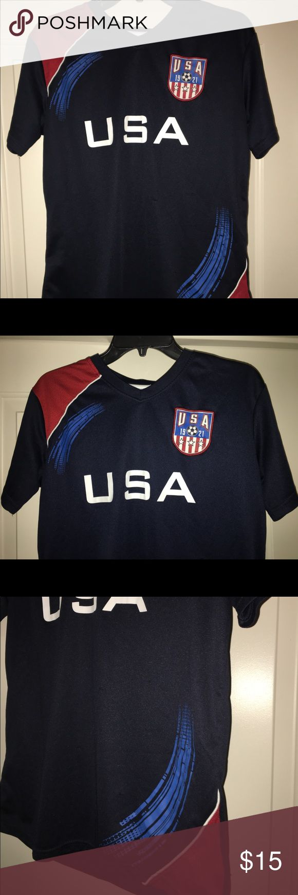 """Boys USA soccer jersey size XL Thank you for viewing my listing, for sale is a youth/boys, navy blue, USA soccer, short sleeve jersey.   #4  Sz: Youth XL 18/20   Jersey is in great condition with no rips or stains. If you have any questions or would like additional photos please feel free to ask.   From under one arm to under the other measures appx 18"""" from the top of the shoulder to the bottom of the Jersey measures appx 25"""" simply sports Shirts & Tops Tees - Short Sleeve"""