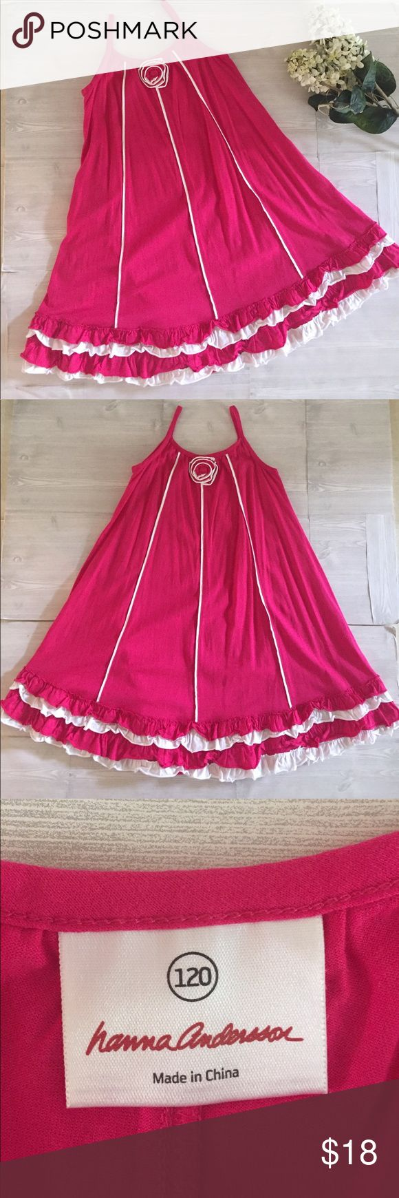 Hanna Andersson Fushia Dress Size 120 6/7 Hanna Andersson Fushia Dress Size 120. Excellent condition, perfect Twirl Dress. Features Ruffle bottom and rosette Ruffle flower on front. See Hanna Andersson size chart in pics for sizing. Hanna Andersson Dresses