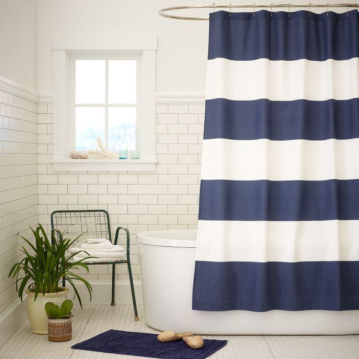 Tiled bath with navy striped curtain