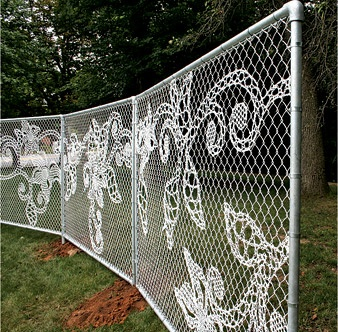 yarn bomb. Only attractive chain link fence I've ever seen! If you are stuck with having to have a chain link fence, at least there's something you can do with it....