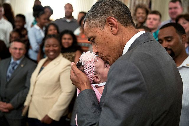 This is the cutest! <3   President Barack Obama kisses a baby girl as he and Vice President Joe Biden greet wounded warriors and their families during their tour in the East Room of the White House, June 23, 2014. (Official White House Photo by Pete Souza)