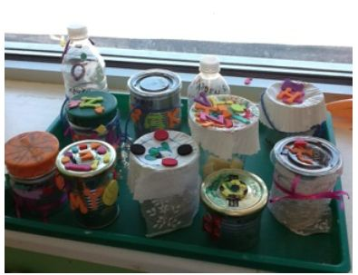"""""""Musical instruments""""  Place at least 3 different sensory bins with seeds, cotton balls, small fish rocks, beads, etc. Give them some cans or recycled containers and let them make their own instrument adding and hearing the different containers filled with the materials from the sensory bins. Let them decorate their instruments using strings, stickers or tissue paper."""