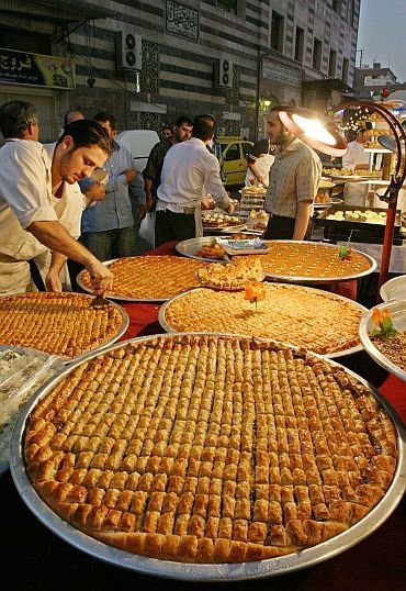 Baklava in Damascus, Syria; the tray size gives you a whiff of what Muslim generosity, hospitality and family size is like lol