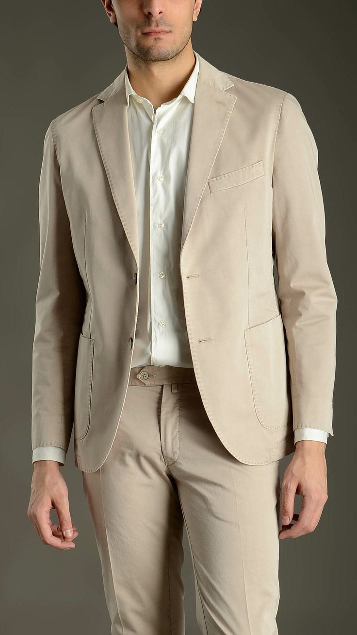 Beige delavè cotton suit characterized by: two button fastening deconstructed jacket, peak lapel, liningless, Neapolitan shoulder, two patch pockets and a chest pocket at front