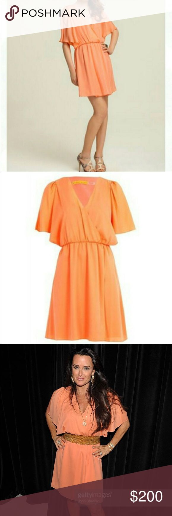 Gorgeous Alice & Olivia Peach Silk Dolman  Beautiful dress with a flattering dolman style top. One small pull noted at inner top, not noticeable when worn because of its location - will post close up photo. In EUC otherwise. Thank you for looking !                                                                                                               smoke and pet free home  Alice + Olivia Dresses