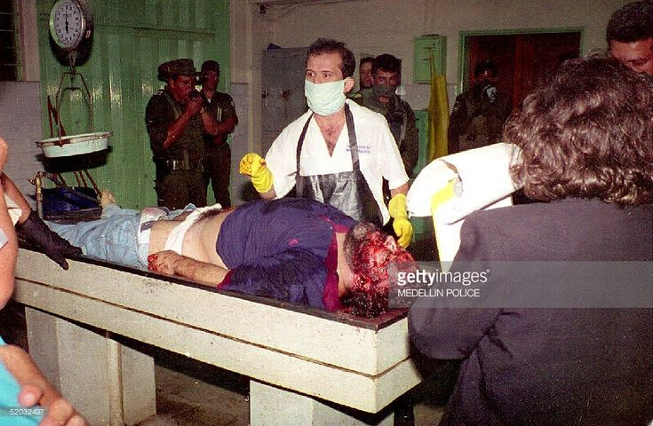 The body of Medellin drug cartel leader Pablo Escobar is examined by coroners at the Medellin morgue in Colombia late 02 December 1994 hours after Escobar was killed by Colombian police in a shootout as Escobar tried to escape arrest.