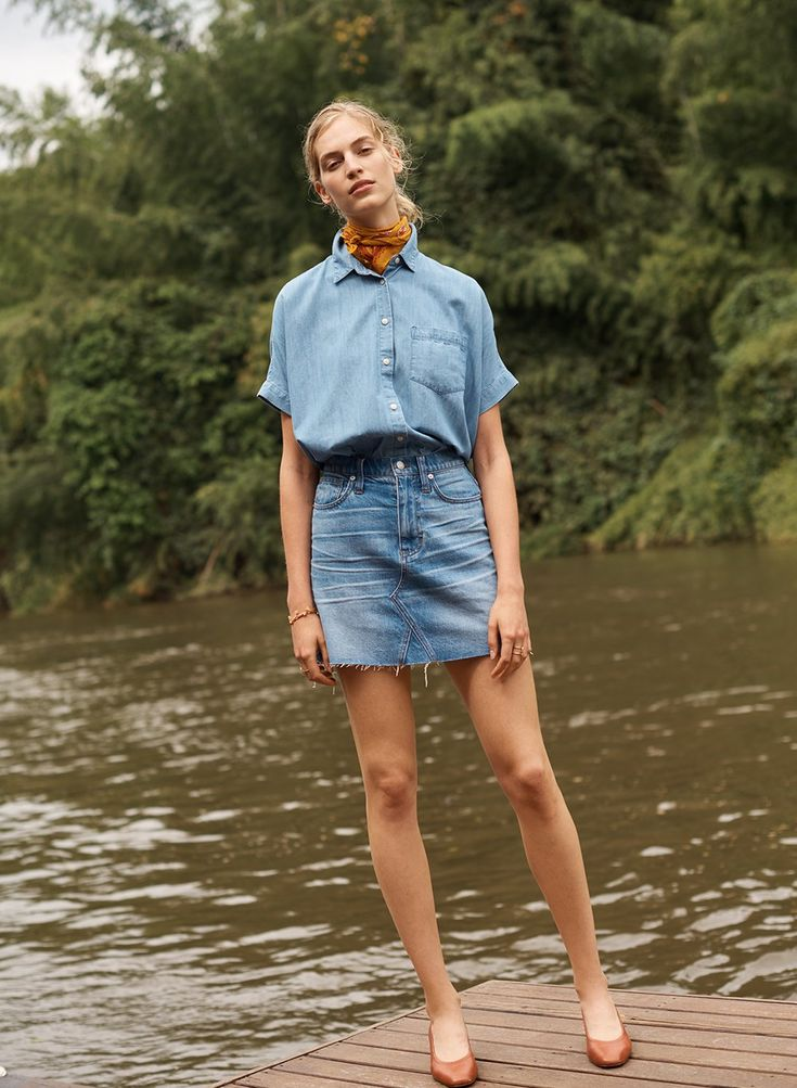 madewell frisco mini skirt worn with denim short-sleeve tie-front shirt, bandana + the raquel pump.
