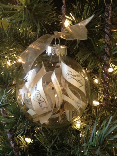 Wedding Memory Capsule Christmas Ornament  (Clear glass ornament, white ribbon, curled strips cut from the Wedding Invitation of the important information: Names, wedding date, etc.)