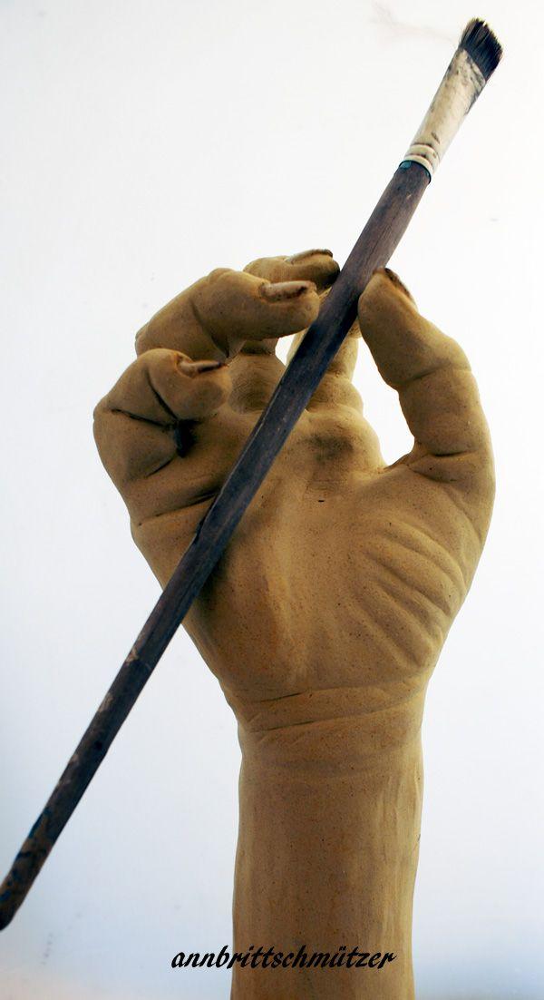 Hand ,stoneware, sculpture.