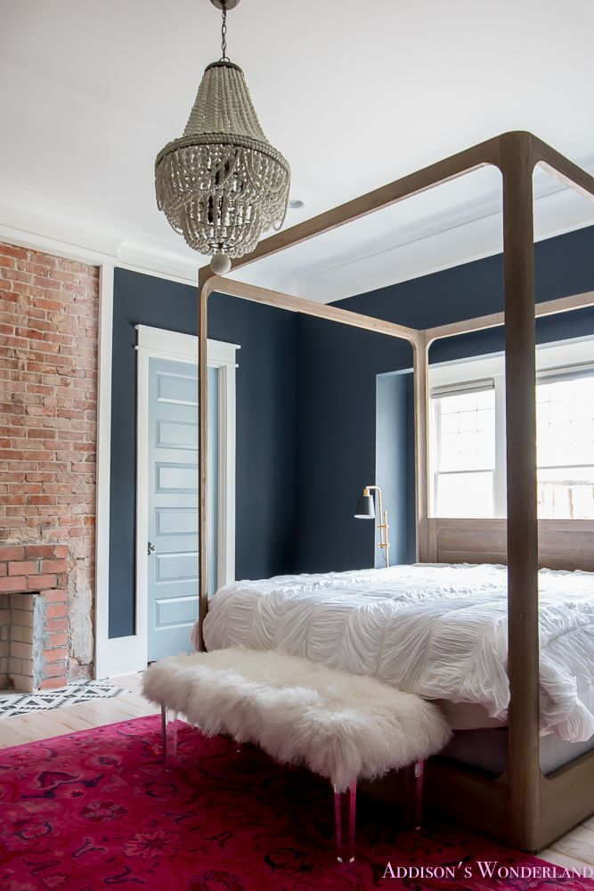 Our dark & moody master bedroom update... Black walls, white trim and a large four poster bed set the stage for fun accessories from HomeGoods! Sponsored by HomeGoods. #sponsored