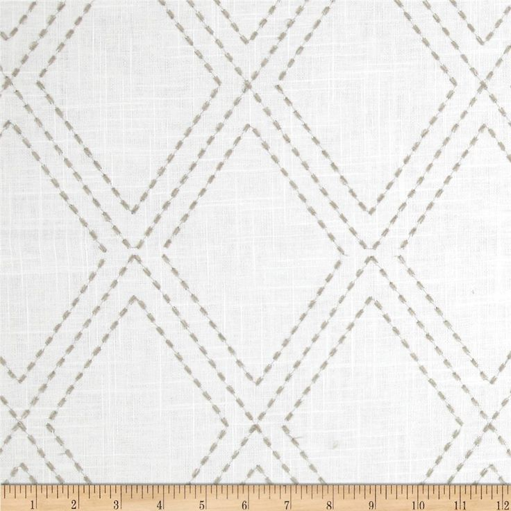 This embroidered linen/cotton blend fabric is medium/heavyweight and perfect for window treatments (draperies, valances, curtains, and swags), toss pillows and some upholstery. Colors include grey embroidery on a white background.
