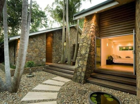 modern beach house exteriors | The stone walls and wooden elements of the house are impressive design ...