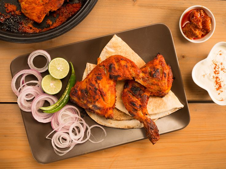 Tandoori Chicken (#LC14013): Tandoori chicken is a grilled chicken marinated with yogurt, lemon juices and plenty of spices in the oven. Traditionally this marinated chicken is made in a 'Tandoor' - a type of cylindrical clay oven, thus got the name Tandoori chicken.