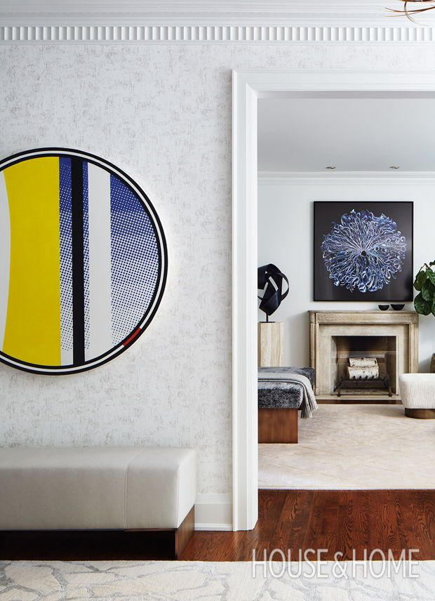 Circular art from douglas couplands mirror series lightens the mood of this wide formal hallway