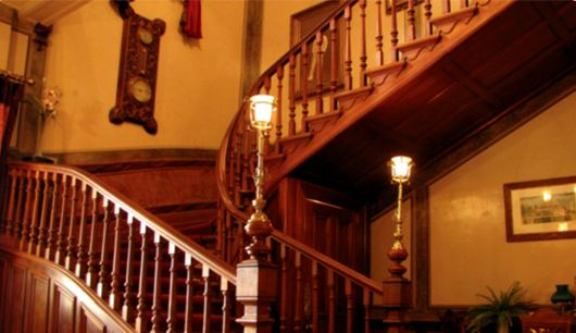 The magnificent teak staircase that sweeps up to the second floor.