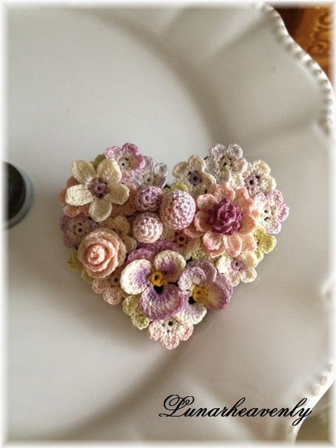 Crochet flowers in a heart