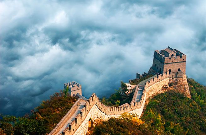 """The Great Wall of China. The Great Wall runs more than 13,000 miles—the distance by plane from New York to Beijing and back. In Chinese, it's called changcheng, literally """"long wall."""" Over thousands of years these walls have been destroyed, rebuilt, maintained, and extended; much of the wall you see today dates to the Ming Dynasty (1368–1644). A handful of sections of the Great Wall are accessible from Beijing."""