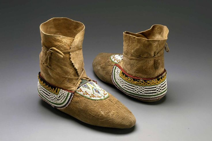 Moccasins Cree - Plains Cree?- Swampy Cree? Collection: Warnock. Period: 1875-1900 Materials: Native tanned moose hide; multi-colored glass seed beads; black wool cloth; cotton cloth; thread sewn. Provenance: Lessard Collection- SD 229 Epic Fine Arts Co./Masco Corp. Splendid Heritage.