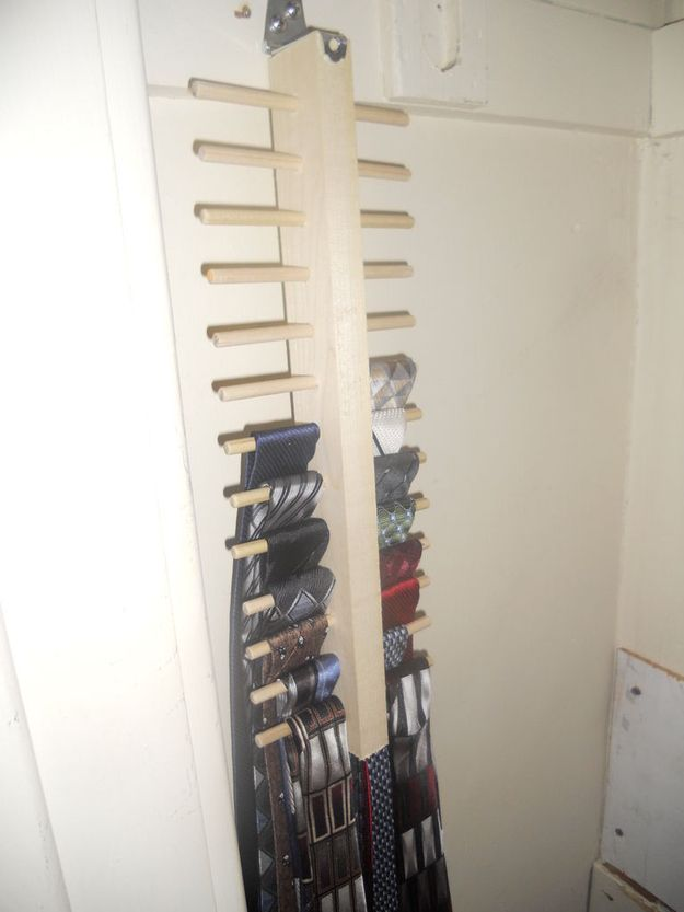 For ties (which hang super flat), stick the tie hanger up against the wall. | 25 Lifehacks For Your Tiny Closet