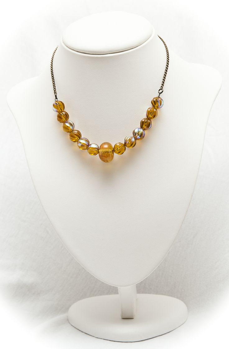 on a chain necklace of gold art glass beads with dichroic glass highlights and carnival glass beads