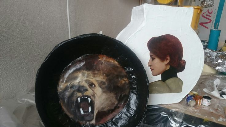 A plate with decoupage decor and one of my vases in the early stages