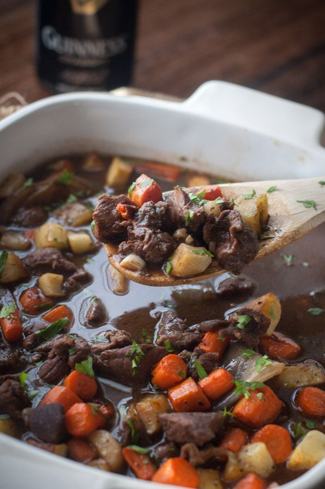 This slow cooker Irish beef stew is the perfect dish for chilly nights! Guinness beer simmers down all day with beef stock, veggies and stew meat to create a delicious savory dinner. Serve with biscuits or a good Irish soda bread.