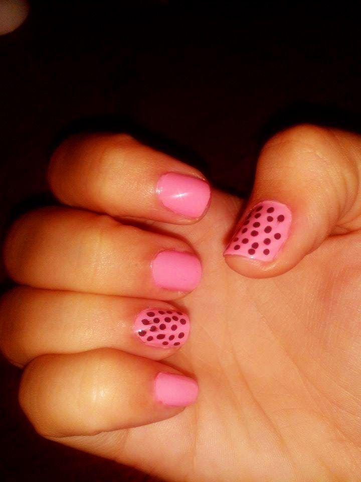 Pink nails with black dots